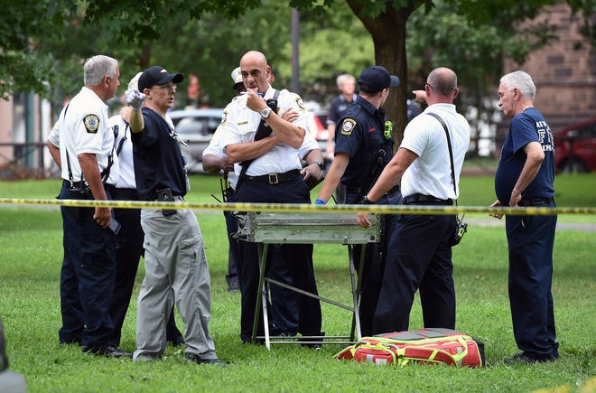 New Haven emergency personnel respond to overdose cases on the New Haven Green in Connecticut on Aug. 15, 2018.