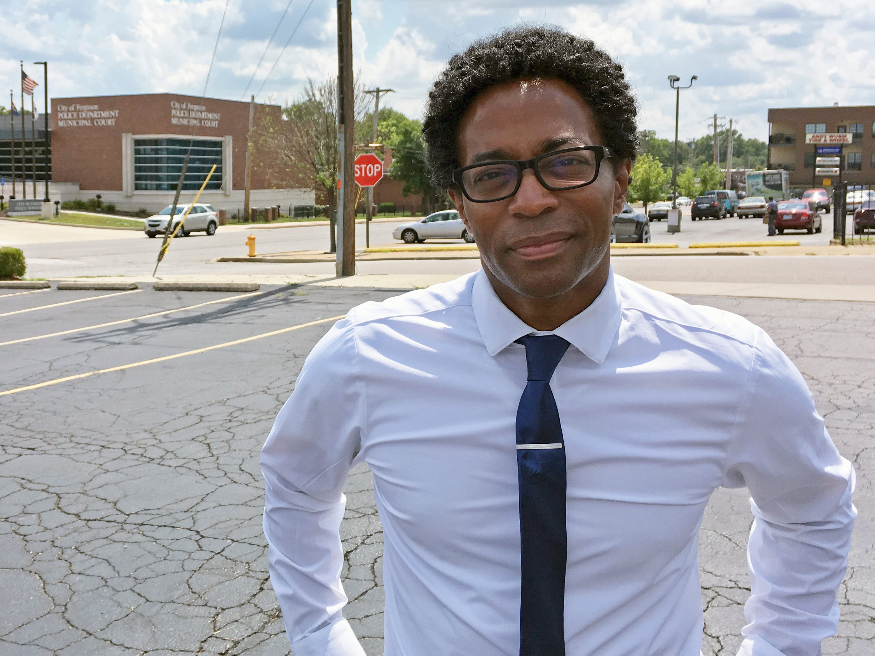 Wesley Bell stands outside the Ferguson, Mo., police headquarters a day after he defeated longtime St. Louis County prosecutor Bob McCulloch in the Democratic primary.