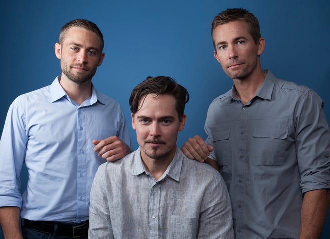 "Cody Walker, from left, Adrian Buitenhuis and Caleb Walker, pose for a portrait in Los Angeles, in promotion of the documentary film ""I Am Paul Walker."""