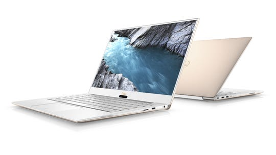 "Dell XPS 13: Dell's ""convertible"" PC can be used in various modes, such as a laptop turning into a tablet, on its 60-degree hinge."