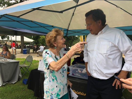 Rep. Dave Brat, R-Va., speaks with a constituent at an event in Chesterfield, Va., Aug. 7, 2018. Brat is running for re-election in a competitive race in Virginia's 7th Congressional District.