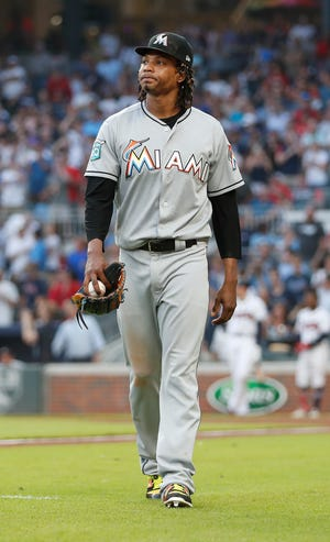 Marlins starting pitcher Jose Urena leaves the field after being ejected for hitting Braves' Ronald Acuna Jr. with a pitch during the first inning.