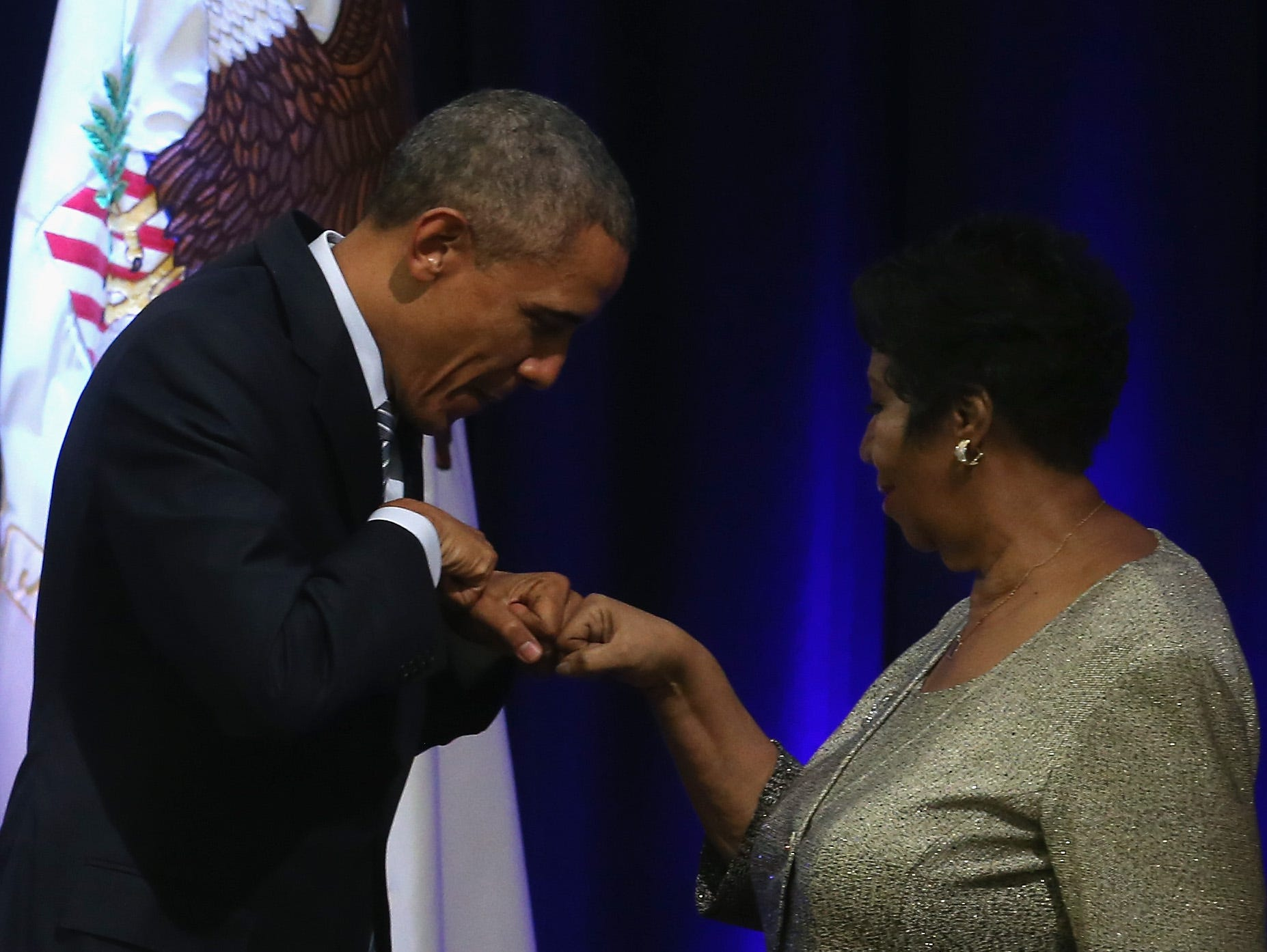 WASHINGTON, DC - FEBRUARY 27: US President Barack Obama fist bumps with singer Aretha Franklin who sung during a farwell ceremony for Attorney General Eric Holder at the Justice Department February 27, 2015 in Washington, DC. The ceremony was held to unveil the Attorney Generals official portrait and commemorate his tenure before his expected departure from the department after more than six years of service. (Photo by Mark Wilson/Getty Images)
