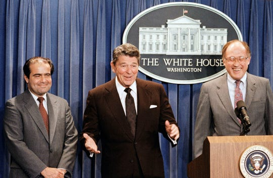 Former chief justice William Rehnquist, shown here with President Ronald Reagan and former associate justice Antonin Scalia, is among Supreme Court nominee Brett Kavanaugh's heroes.