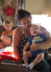 Susan Morales holds her son Holden Krean at their home.