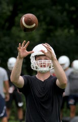 Manalapan High School football QB Sean Kehley catches a ball during practice Tuesday, August 14, 2018.