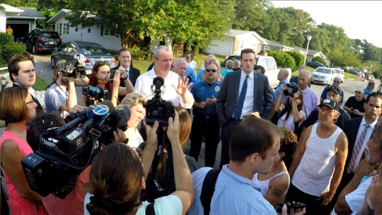 NJ Governor Phil Murphy speaks with Greenbriar community members in Brick Township Friday morning, August 17, 2018, as he visits the damage caused when heavy rain flooded these homes.