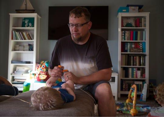 Ty Krean holds his son Wyatt.
