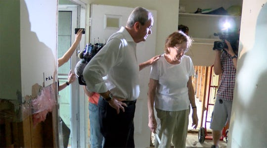 Markham Road resident Renate Kupatt gives NJ Governor Phil Murphy a tour Friday morning, August 17, 2018, of the damage caused when heavy rain flooded his Greenbriar community home in Brick Township.