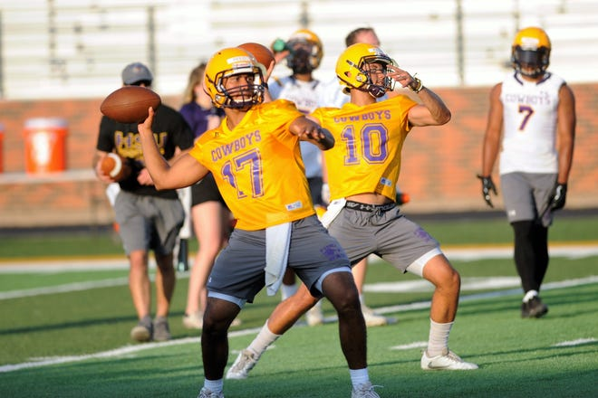Hardin-Simmons quarterbacks Marc Reed (17) and Peyton Killam (10) throw during the Cowboys' first fall practice at Shelton Stadium on Thursday.
