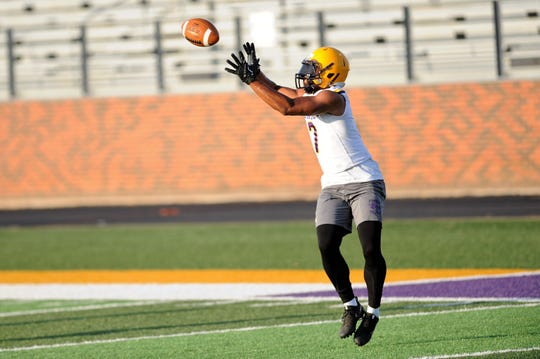 Hardin-Simmons receiver Alex Bell jumps to make a catch during the Cowboys' first fall practice at Shelton Stadium on Thursday.