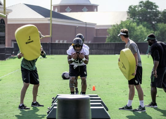 Abram Smith gets set for a drill during summer  workouts at Baylor.