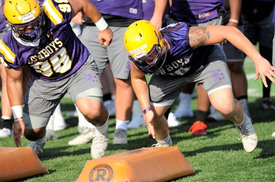 Hardin-Simmons defensive lineman Hunter Creasey goes through a drill during the Cowboys' first fall practice.