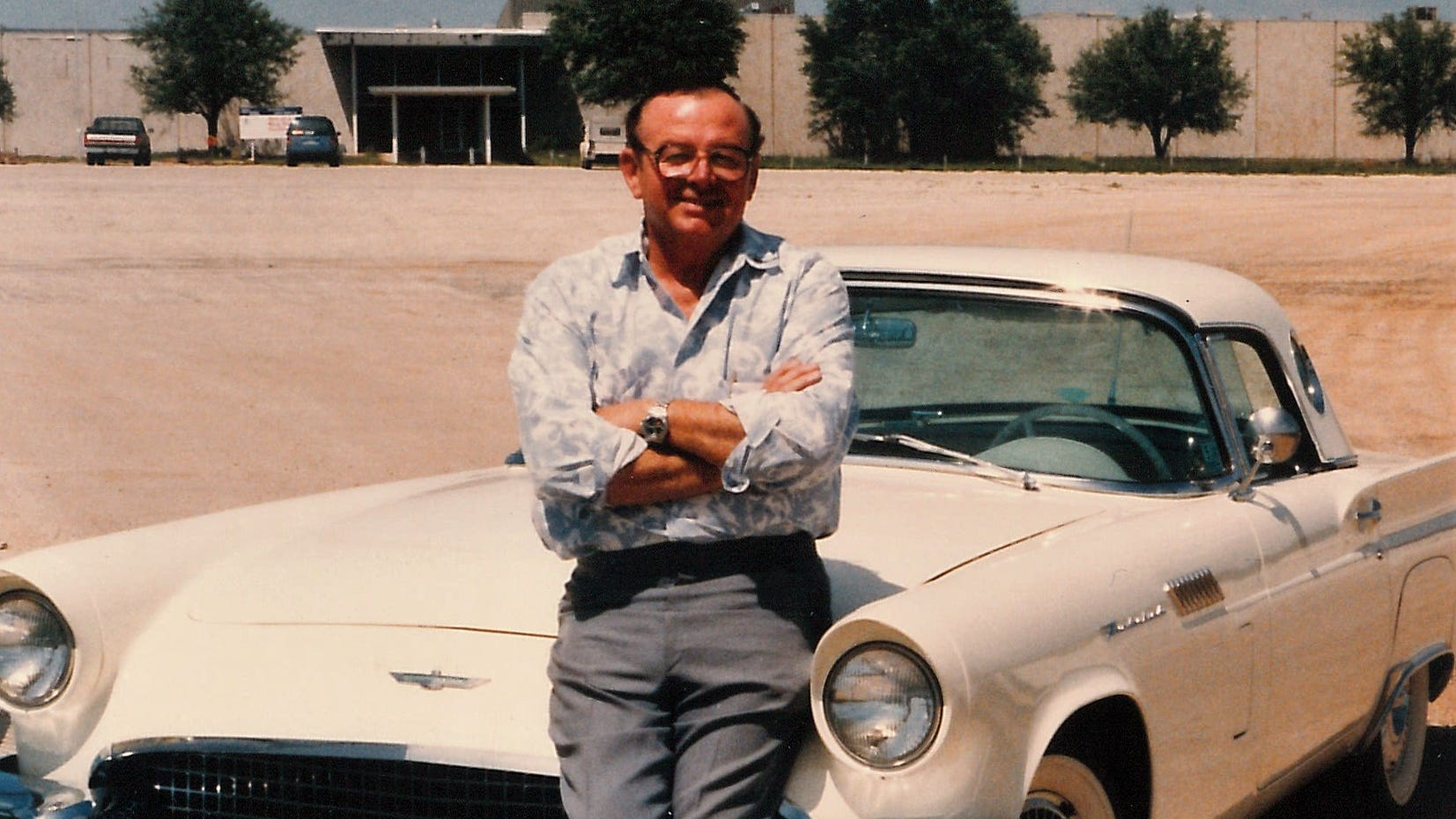 Tommy Wideman poses in 1992 outside what used to be the Aileen clothing plant. The building was empty for years before Coca-Cola and other companies began using it for warehouse space and other purposes. Before tenants were found, Wideman told people he managed the fifth largest empty building in Texas.