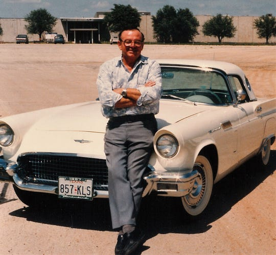 Tom Wideman poses in 1992 outside what used to be the Aileen clothing plant. The building was empty for years before Coca-Cola and other companies began using it for warehouse space and other purposes. Before tenants were found, Wideman told people he managed the fifth largest empty building in Texas.