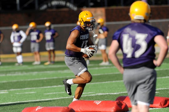 Cowboys linebacker Eriq Mitchell comes down with the ball during a drill in the teams's first fall practice at Shelton Stadium on Thursday.