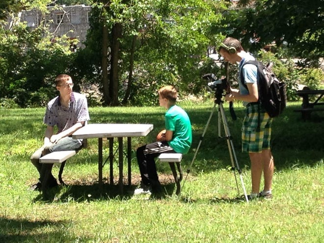 "From left, Dylan Dexter and Francisco Mateo Santander Martinez film a scene on Blannahassett Island for ""31 Days in Marshall, North Carolina"" as Joel Haver handles the camera."