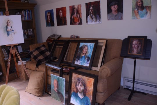 Portraits preparing to be framed in Nan Sherry's studio.