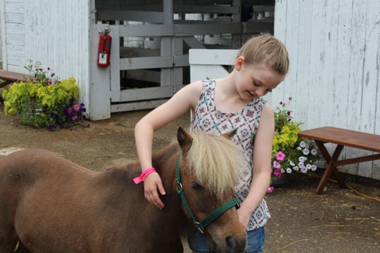 Maeve Russell and her miniature horse, Shamrock.