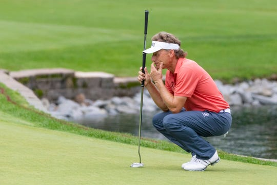 Bernhard Langer sizes up a putt at En-Joie Golf Course.