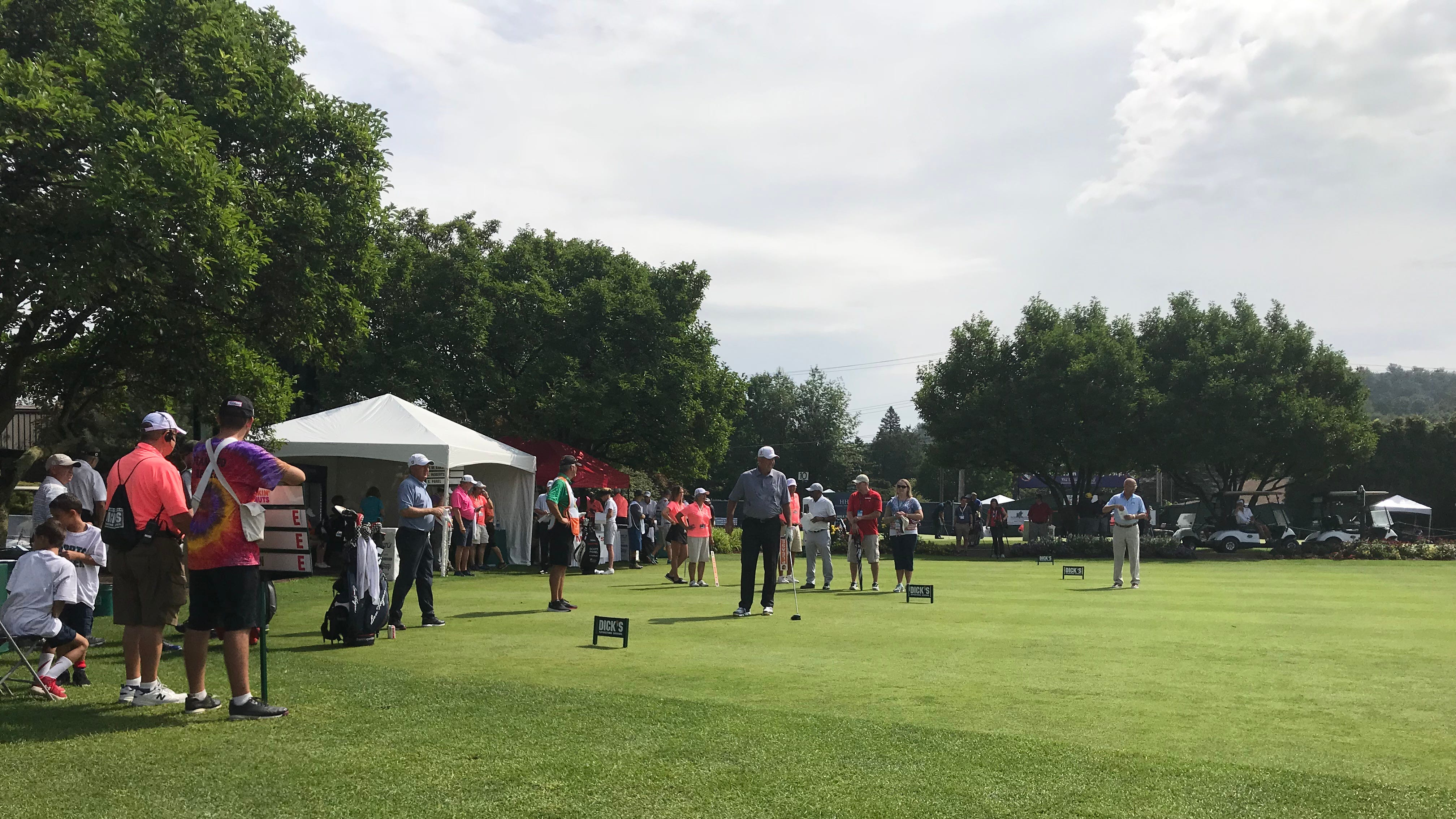 Groups of golfers began teeing off at about 10 a.m. Friday.