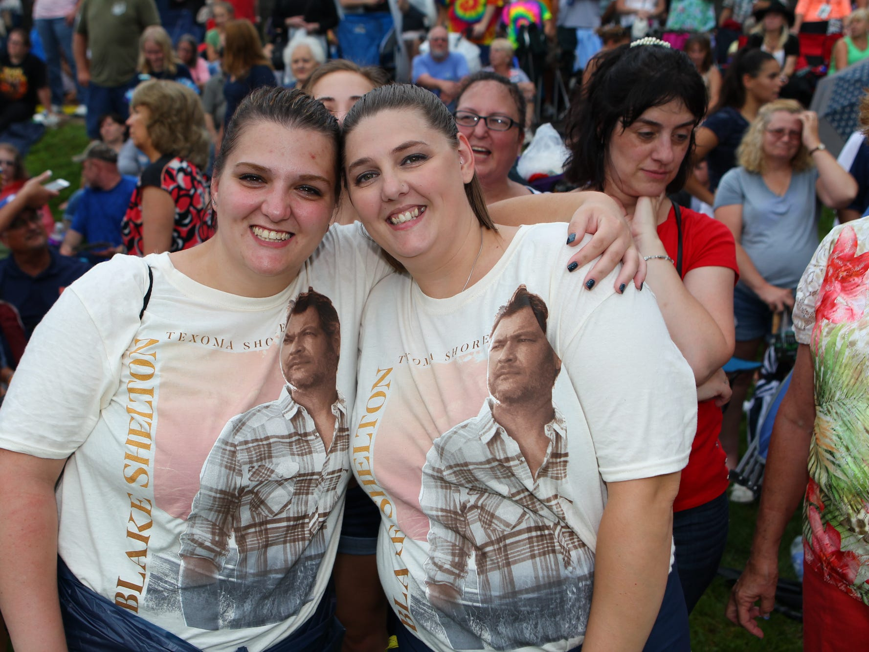 Alyssa Driedbaugh and Breonna Fuller wait in line with their Blake Shelton shirts.