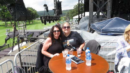 Cindy Gregoris, left, and Kristen Lawrence laid claim to their seats just to the right of the stage for Friday night's Blake Shelton show at the Dick's Sporting Goods Open.