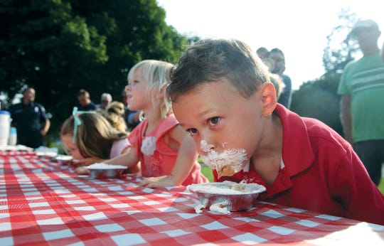 Jax Rhodes, 5, of Kingston competes in the pie-eating contest at the 10th annual Village Green Foundation's Pie in the Park celebration on Thursday.