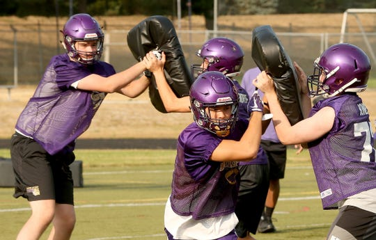 North Kitsap opens the 2018 season with a home game against Bainbridge in Poulsbo. The Vikings beat the Spartans 42-21 last season.