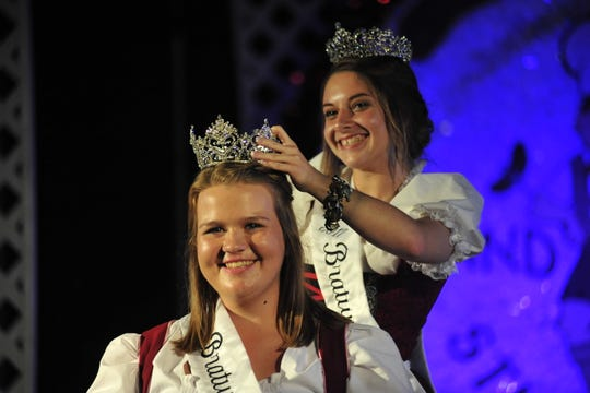 Emily Rudd smiles as the 2018 Bucyrus Bratwurst Festival Queen's tiara is placed on her head by outgoing queen Allison Lawson. This year's queen's pageant will start at 8 p.m. Thursday, Aug. 15, on the Rensselaer Stage.