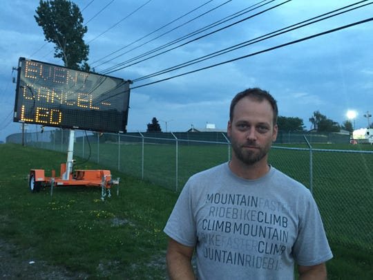 Steve Leensvaart of Minneapolis stands outside the gates on Aug. 16, 2018, where Phish's Curveball festival was to be held in Watkins Glen, N.Y. before it was canceled.