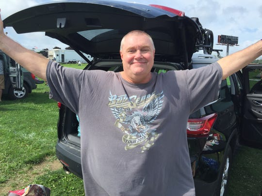 Jim Gregory of Boston wonders what to do next as he gets ready to leave Phish's canceled Curveball festival in Watkins Glen, N.Y., on Aug. 17, 2018.