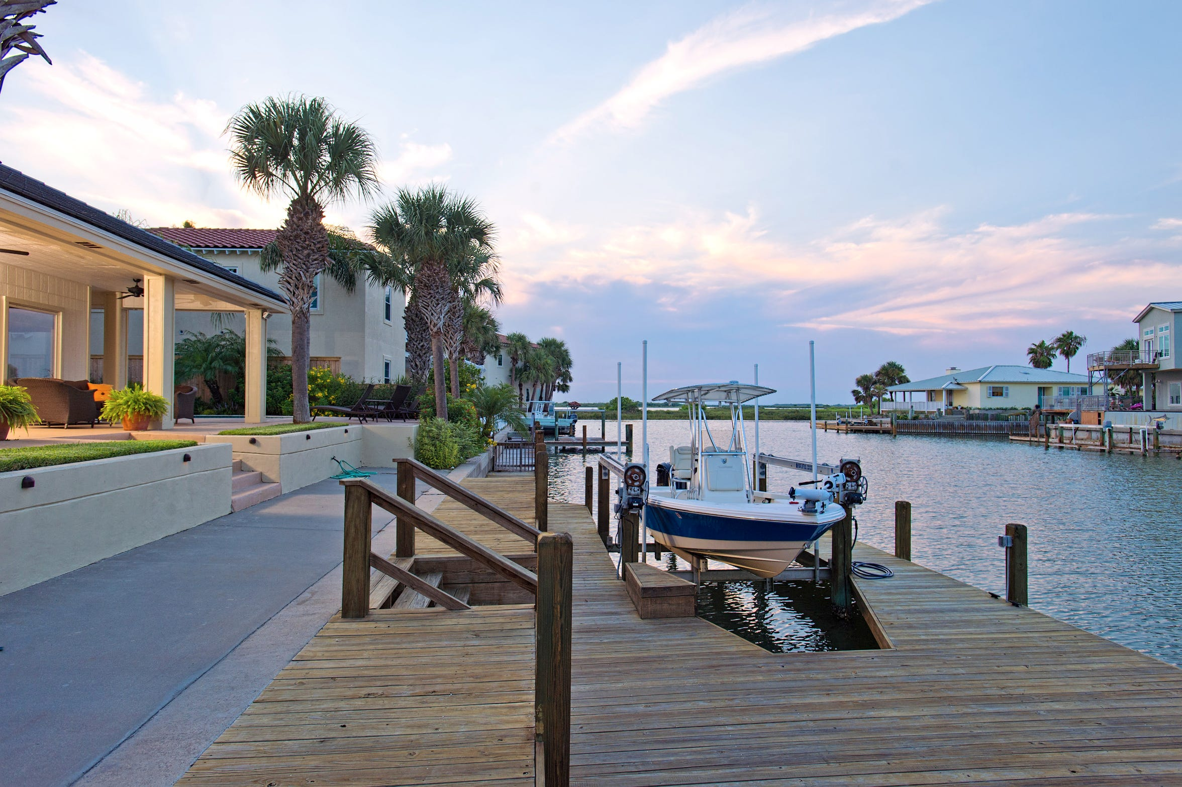 Your boat awaits on the expansive dock/ deck on the Island Moorings canal.  Head out to some of the areas finest fishing right from the back door of this Port Aransas home.