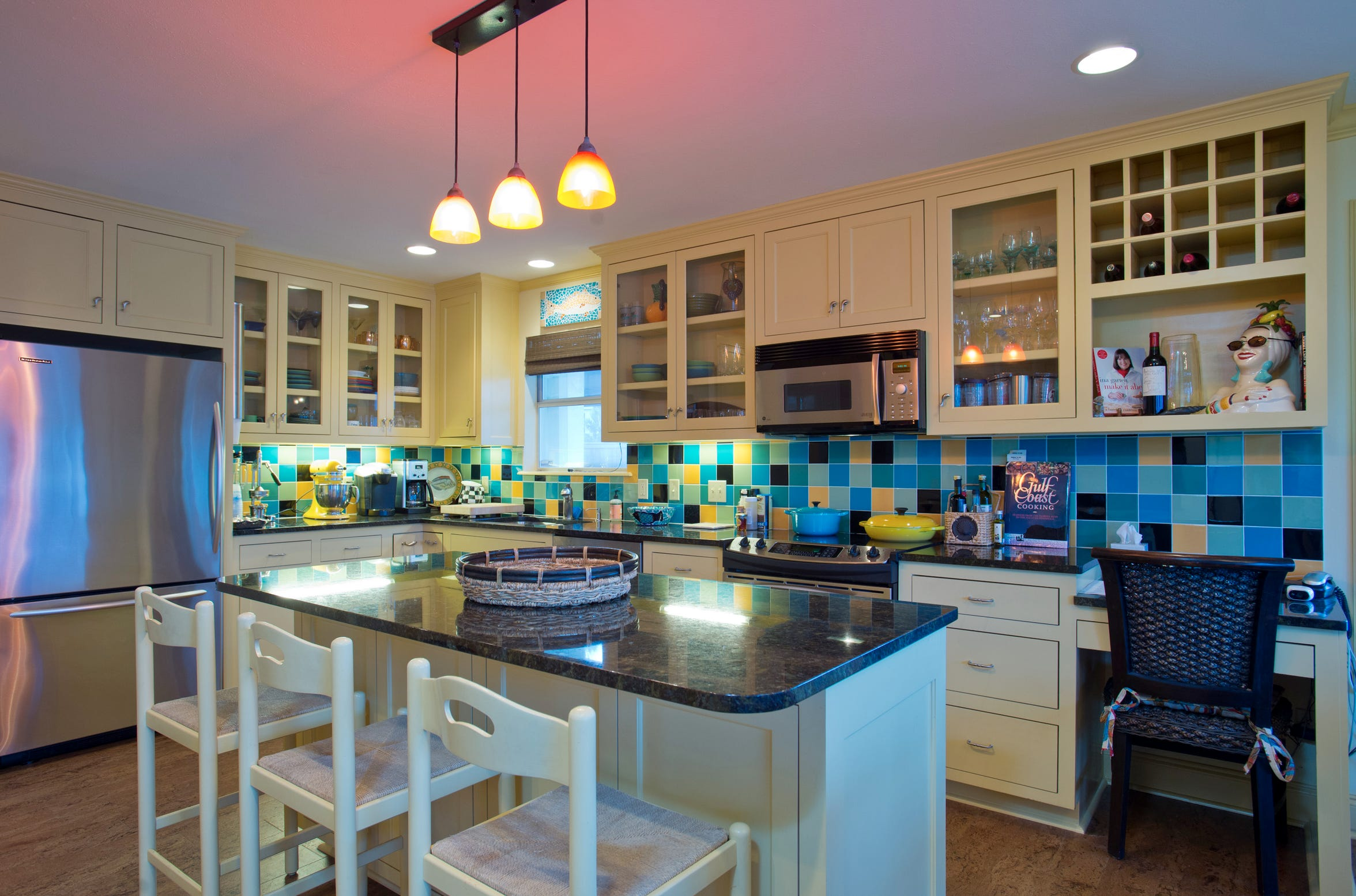 The kitchen is alive in color making it the perfect spot for entertaining while cooking up the catch of the day.