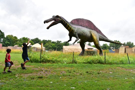 Brothers Lance, 8, and Gavin Gailyard, 5, of Staten Island, N.Y., react to the sight of a Spinosaurus, the newest dinosaur at Field Station: Dinosaurs in Leonia. The Spinosaurus was voted in by children to be exhibited this season, and it is the largest dinosaur in the park.  Marko Georgiev/NorthJersey.com Brothers Lance 8, and Gavin Gailyard, 5, of Staten Island, NY, react to the sight of a Spinosaurus, the newest dinosaurs at Field Station in Leonia. The Spinosaurus was voted in by the children to be exhibited this season at Overpeck Park in Leonia and it is the largest Dinosaurs in the park.