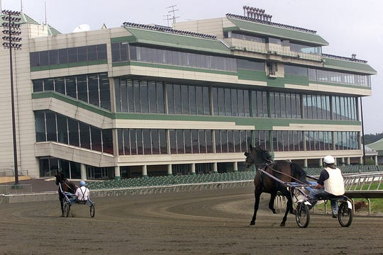-  Standardbreds work out on the track at Garden State Park in Cherry Hill in a 1999 file photo.