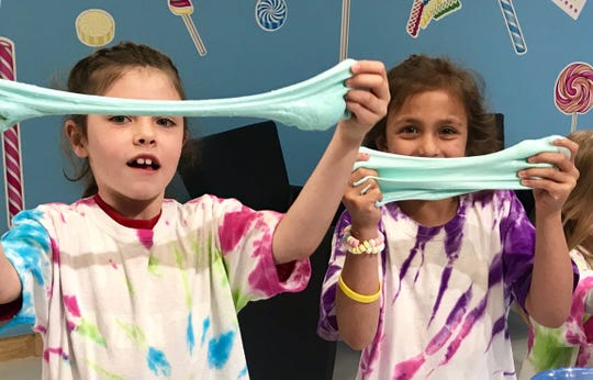 Kids have fun with slime and candy bracelets at Rocket Fizz in Westmont.