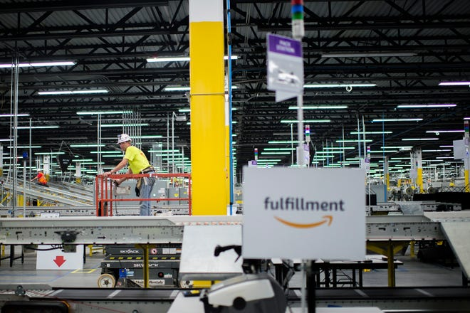 Construction ensues at the new Amazon fulfillment center Friday, Aug. 17, 2018 in West Deptford, N.J.