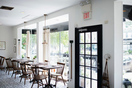 The main dining area offers an abundance of natural light at Porch & Proper in Collingswood.