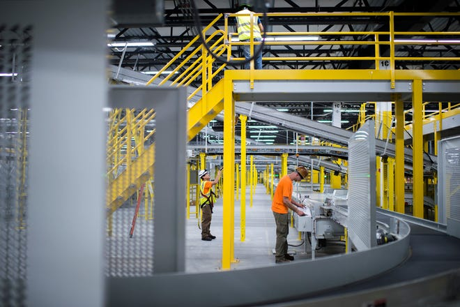 Maintenance ensues at the new Amazon fulfillment center Friday, Aug. 17, 2018 in West Deptford, N.J.