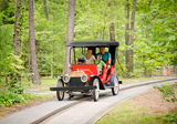 In the new Kings Mills Antique Autos family ride, guests will board replica classic touring cars and take a leisurely drive around a scenic track.