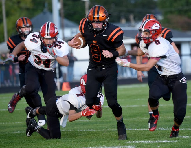 Ridgewood's Kaden Smith tries to dodge Coshocton defenders in a game last season. Smith is one of several players returning for a young Generals' squad.