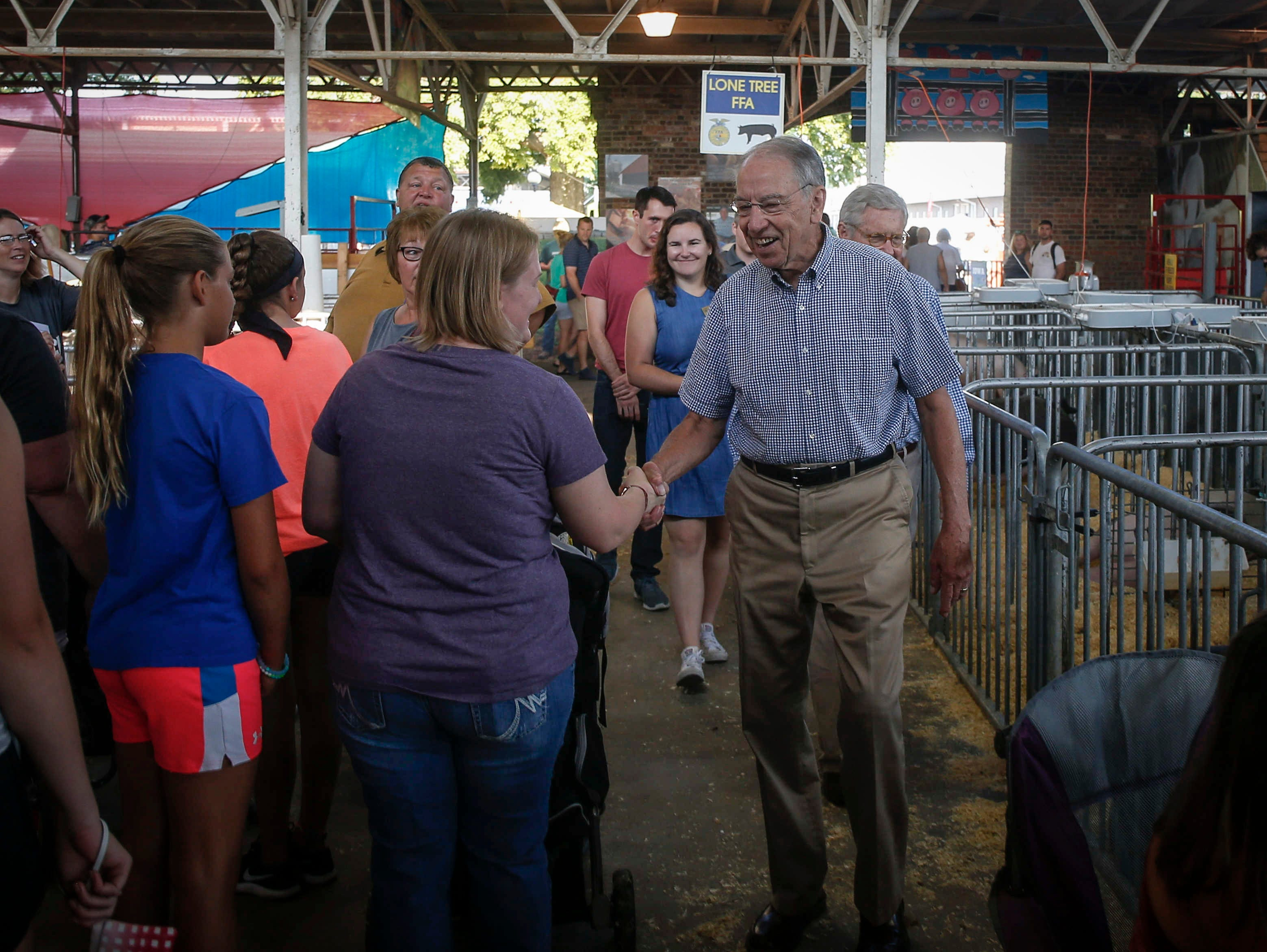 U.S. Sen. Charles Grassley (R-Iowa) greets supporters in the swine barn on Friday, Aug. 10, 2018, at the Iowa State Fair in Des Moines.