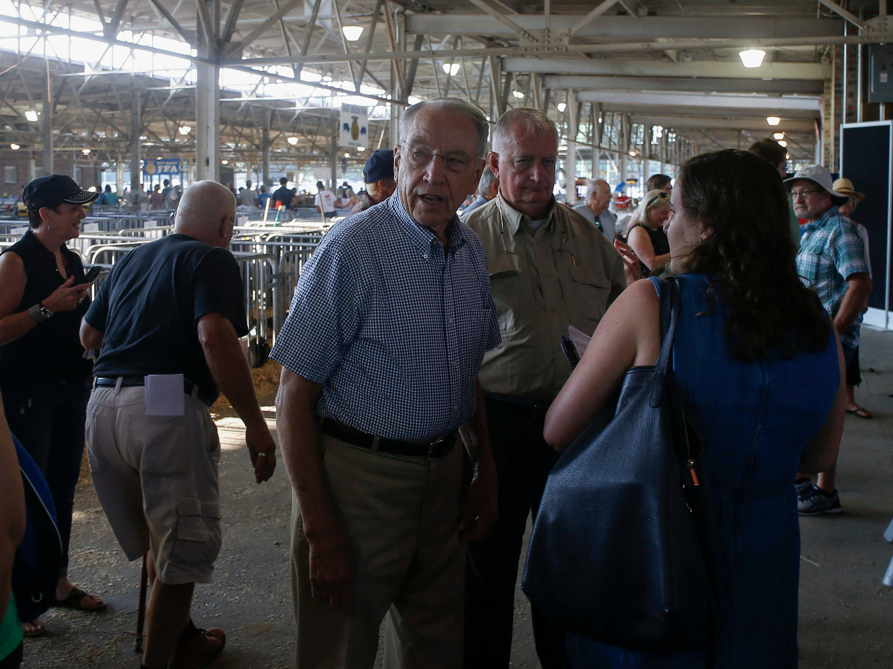U.S. Sen. Charles Grassley (R-Iowa) meets with supporters near the Big Boar pens at the swine barn on Friday, Aug. 10, 2018, at the Iowa State Fair in Des Moines.