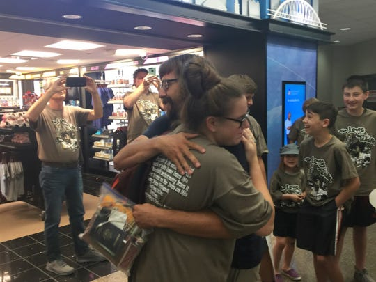 Stephen Skinner of Bondurant hugs his sister at the Des Moines International Airport on Friday, Aug. 17, 2018. Skinner and his friend Max Granfield walked from Iowa City to Portland, Maine, beginning on June 2.
