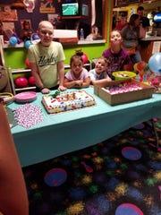Caleb Hammond, 11, of Oskaloosa, pictured alongside is siblings.