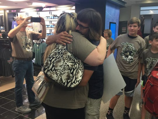 Stephen Skinner of Bondurant hugs his mother, Heather Brown, at the Des Moines International Airport on Friday, Aug. 17, 2018. Skinner and his friend Max Granfield walked from Iowa City to Portland, Maine, beginning on June 2.