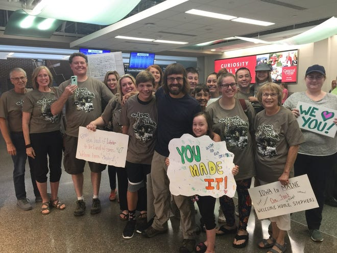 Stephen Skinner's family and friends greeted him at the Des Moines International Airport on Friday, Aug. 17, 2018. Skinner and his friend Max Granfield walked from Iowa City to Portland, Maine, beginning on June 2.