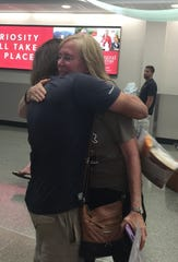 Stephen Skinner of Bondurant hugs his grandmother at the Des Moines International Airport on Friday, Aug. 17, 2018. Skinner and his friend Max Granfield walked from Iowa City to Portland, Maine, beginning on June 2.