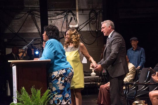 Aretha Franklin, center, is assisted by Music Hall president Vince Paul during a press event for Detroit Music Weekend on June 8, 2017.